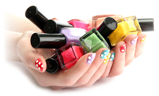 colorful nail polish in women's hands with colorful painted fingernails
